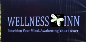 Wellness Inn sign